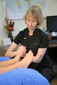 Sarah Rutehrford performing reflexology on feet